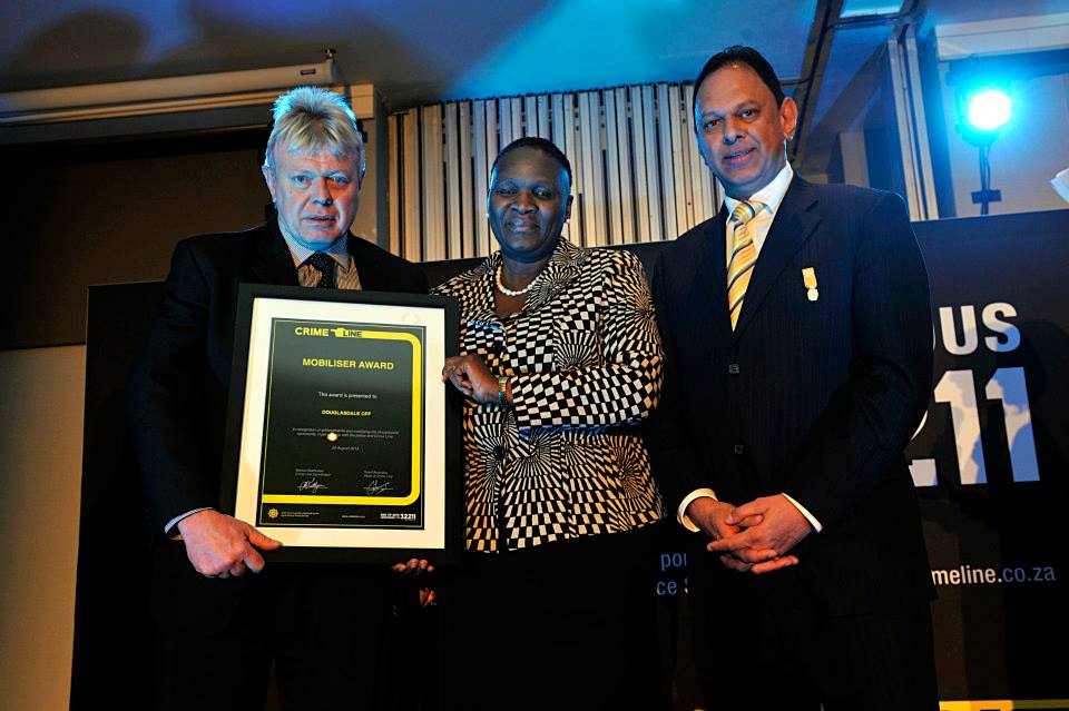 Jean T H Berdou receiving an award on behalf of the Douglasdale CPF. — with Yusuf Abramjee at The Maslow Hotel.
