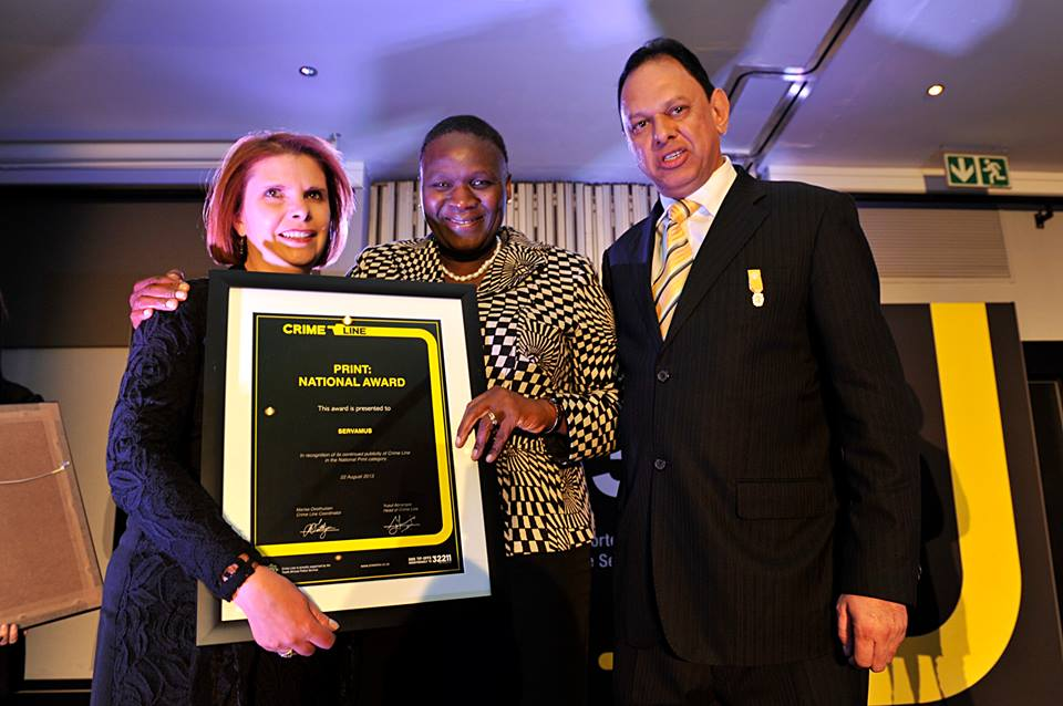 Receiving SERVAMUS' Print: National award from Gen Phiyega and Yusuf Abramjee during last week's Crime Line ceremony. — with Annalise Kempen, Gen Riah Phiyega and Yusuf Abramjee at The Maslow Hotel.